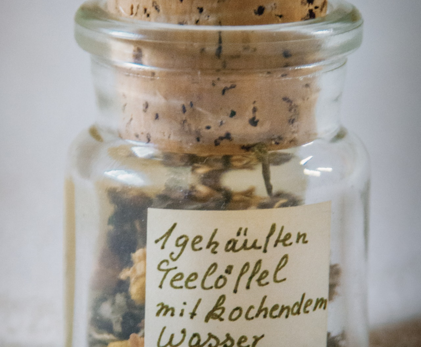 glass jar with cork and label in european language